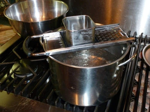 Place spaetzle maker over salted, rapidly boiling water