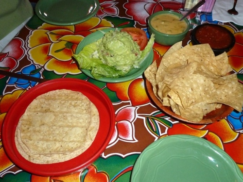 Tostada Chips, Salsa (spicy), Corn Tortillas, and other appetizers on display