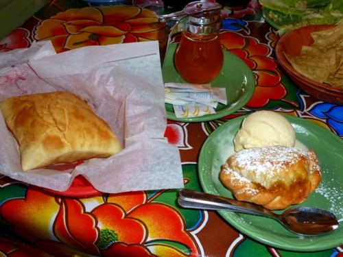 Sopapilla with honey on the left; Apricot Empanada a la Mode to the right