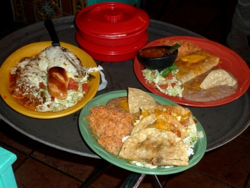 """Another table gets Ground Sirloin with Queso and Green Chili, Burrito (the original """"wrap""""), and a Taco Plate"""