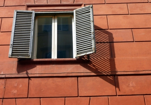 The Window — Rule of Thirds; Negative space framing; Interesting shutter shadow