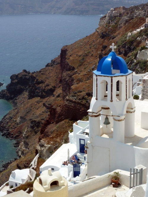 Caldera Overlook in Santorini — Rule of Thirds, splash of blue color framed against a dramatic backdrop