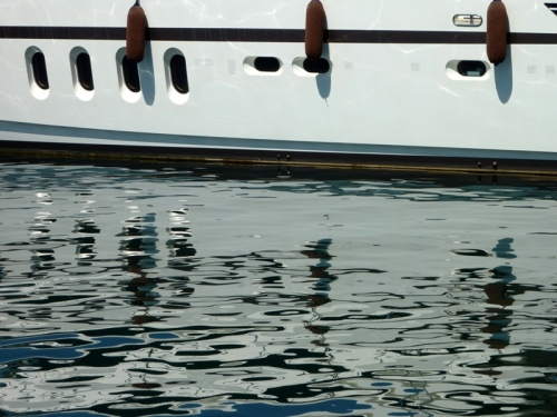 Reflections in St. Tropez — Rule of Thirds (hull/waterline) and gentle, wavy water reflection