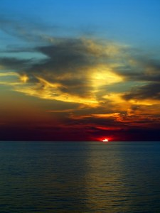 Sunset at Sea — Rule of Thirds; Use of Portrait Orientation; Dramatic Range of Color