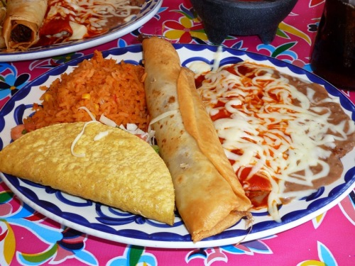 Combination Plate — rice, frijoles, red enchilada, meat and potato taco, beef chimichanga