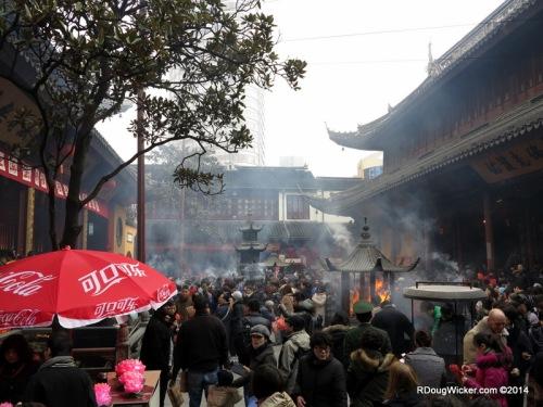 Temple Crowds and Hazy Smoke