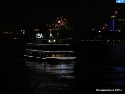 Huangpu cruise boat with fireworks in the background
