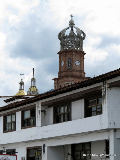 Church of Our Lady of Guadalupe peeking over the rooftops