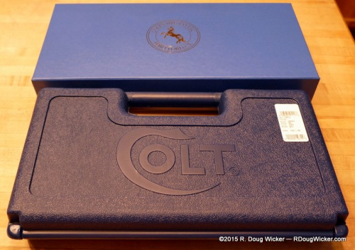 Standard Colt plastic case next to Colt Custom Shop box