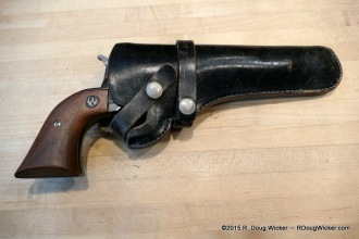 Single-Six resting it her holster