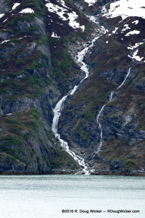 Waterfall cascading into Glacier Bay