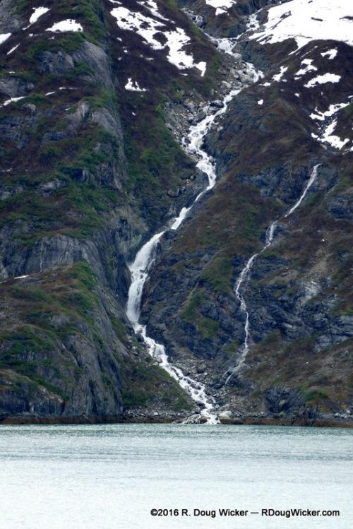 Waterfall cascading into Glacier Bay