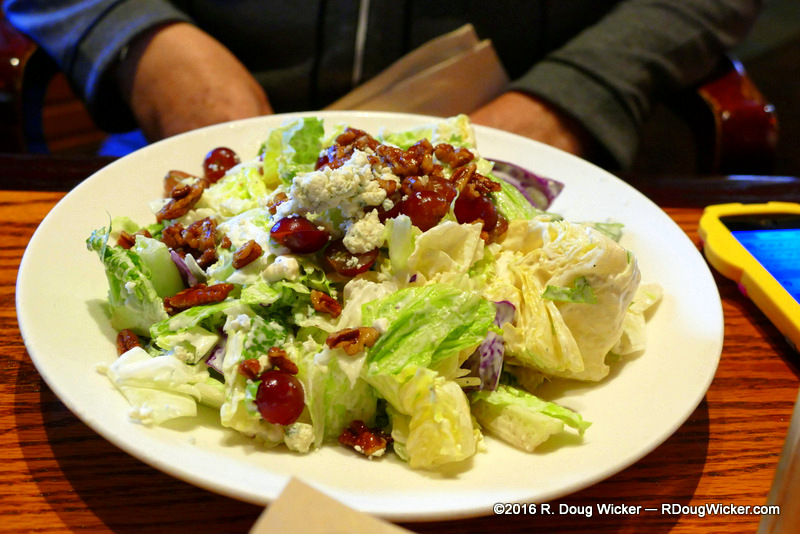 Brewhouse Blue salad — Seasonal mixed greens, red flame grapes, caramelized pecans, blue cheese crumbl