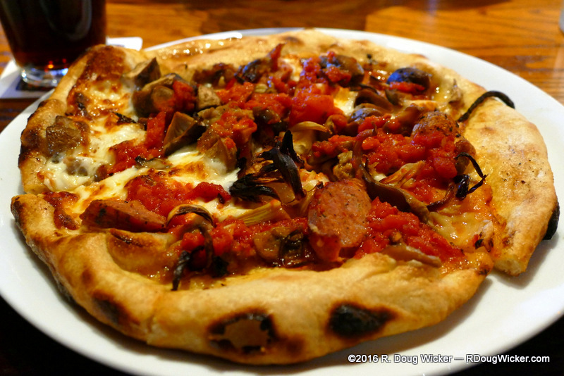 Zoe's spicy coppa and pepperoni, Italian and Andouille sausage, crisp bacon and fresh mozzarella with house made marinara