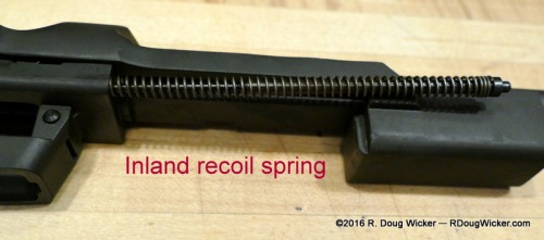 Recoil spring removed from the piston housing