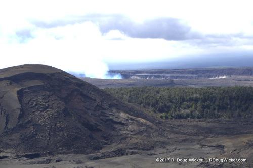 Kilauea Iki Crater — Kilauea Caldera smoking in the background